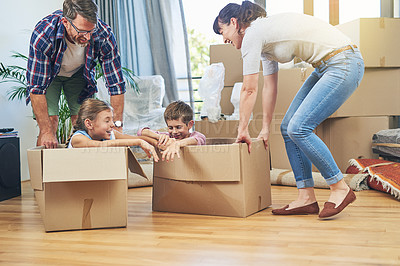 Buy stock photo Shot of a happy family having fun together on moving day