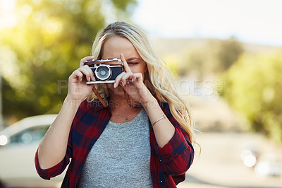 Buy stock photo Cropped shot of a young beautiful woman taking a photo in the city