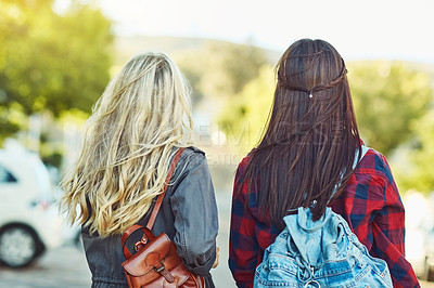 Buy stock photo Rearview shot of two unrecognizable female friends sight seeing in the city