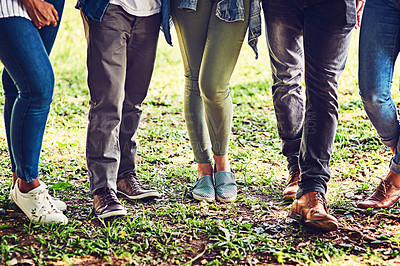 Buy stock photo Closeup shot of an unrecognizable group of friends standing together outdoors
