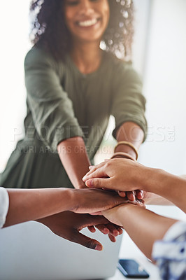 Buy stock photo Cropped shot of a group of  unrecognizable businesswomen piling their hands on top of each other in the office