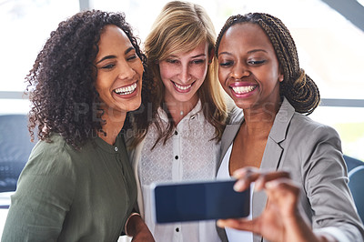 Buy stock photo Cropped shot of a group of  businesswomen taking a selfie in the office