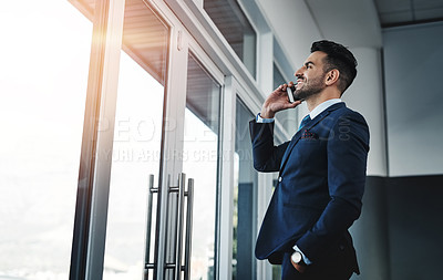 Buy stock photo Cropped shot of a handsome male executive working in a modern office