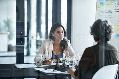 Buy stock photo Shot of two businesswomen having a meeting in an office