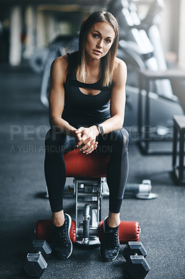 Buy stock photo Portrait of an attractive young woman working out in the gym