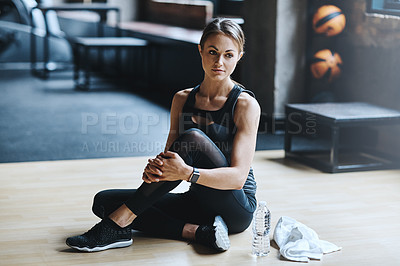 Buy stock photo Shot of an attractive young woman working out in the gym
