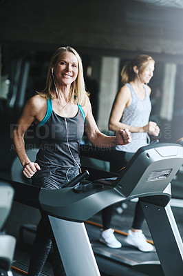 Buy stock photo Shot of women working out in the gym
