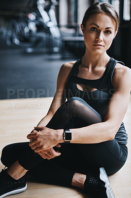 Buy stock photo Cropped portrait of an attractive young woman working out in the gym