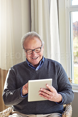 Buy stock photo Shot of a senior man relaxing at home