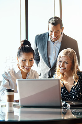 Buy stock photo Cropped shot of three young businesspeople working together in a modern office