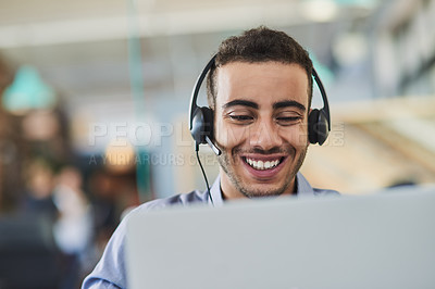 Buy stock photo Shot of a young call centre agent working in an office