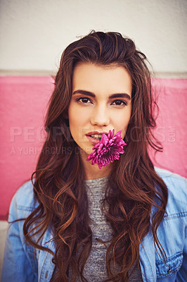 Buy stock photo Portrait of a beautiful young woman posing against a wall outside