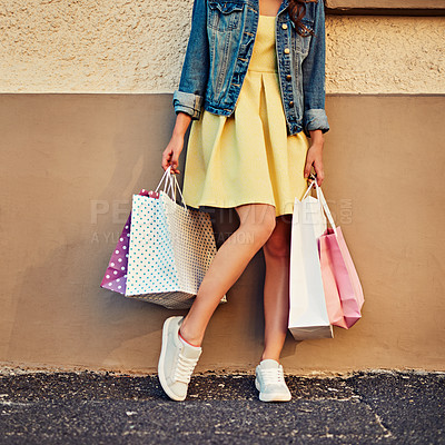 Buy stock photo Cropped shot of an unrecognizable woman on a shopping spree in the city