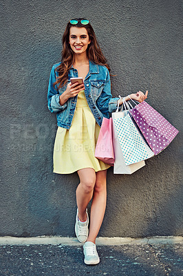 Buy stock photo Shot of a beautiful young woman on a shopping spree in the city