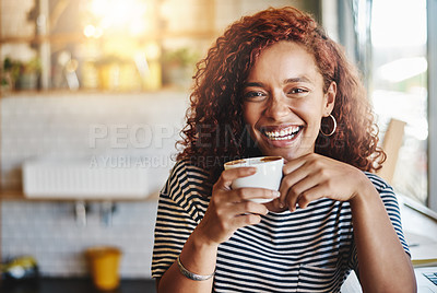 Buy stock photo Portrait of an attractive young woman enjoying a cup of coffee in a cafe