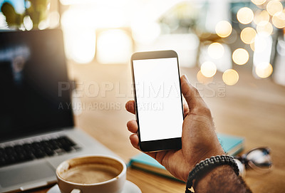Buy stock photo Closeup shot of an unrecognizable man holding up a cellphone with a blank screen in a cafe