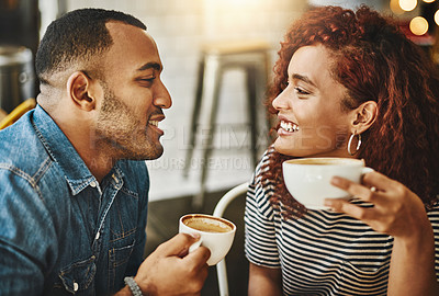 Buy stock photo Cropped shot of an affectionate young couple enjoying their date in the coffee shop