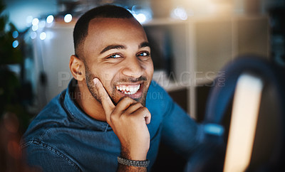 Buy stock photo Portrait of a young businessman using a computer during a late night at work in a modern office