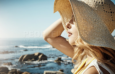 Buy stock photo Shot of an attractive young woman spending a summer's day on the beach