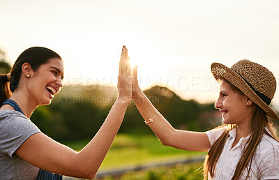 Buy stock photo Cropped shot of an attractive young woman high fiving while working on their family farm