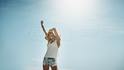 Buy stock photo Portrait of an attractive young woman enjoying a summer's day outdoors