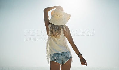 Buy stock photo Rearview shot of an attractive young woman enjoying a summer's day outdoors