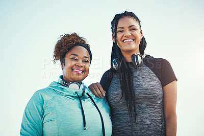 Buy stock photo Portrait of two sporty young women standing together outdoors