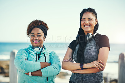 Buy stock photo Portrait of two sporty young women standing on the promenade