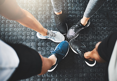 Buy stock photo Cropped shot of a group of people standing together in a circle at the gym