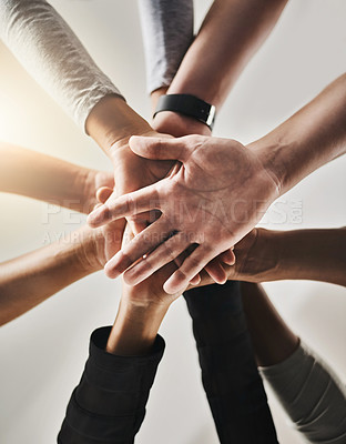 Buy stock photo Cropped shot of a group of people joining their hands together in solidarity at a gym