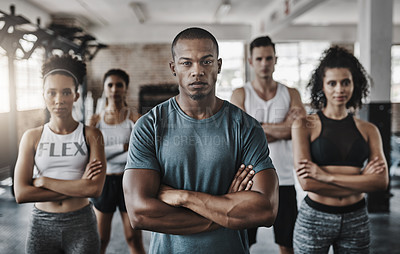 Buy stock photo Portrait of a group of confident young people working out together in a gym