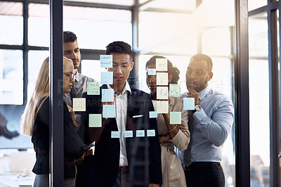 Buy stock photo Cropped shot of a group of businesspeople having a brainstorming session in a modern office