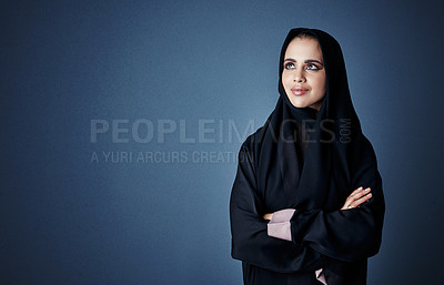 Buy stock photo Cropped shot of an attractive young businesswoman standing with her arms folded against a dark background