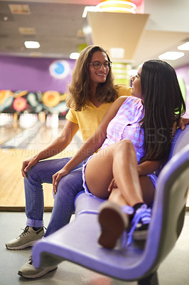 Buy stock photo Shot of a beautiful young couple on a date in a bowling alley