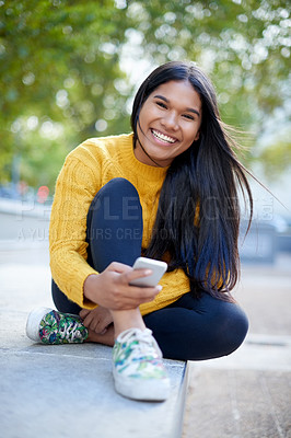 Buy stock photo Shot of a beautiful young female student on campus