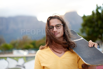 Buy stock photo Portrait of a handsome young man at a skatepark outside