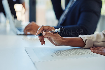 Buy stock photo Cropped shot of a businesswoman going through paperwork during a meeting in the boardroom of a modern office