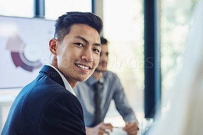 Buy stock photo Portrait of a confident young businessman having a meeting with colleagues in the boardroom of a modern office