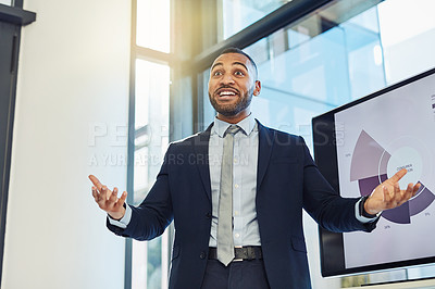 Buy stock photo Shot of a young businessman enthusiastically delivering a presentation in the boardroom of a modern office