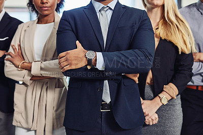 Buy stock photo Cropped shot of a group of confident and diverse young businesspeople working together in a modern office