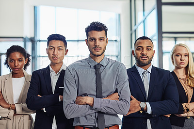 Buy stock photo Shot of a group of confident and diverse young businesspeople working together in a modern office