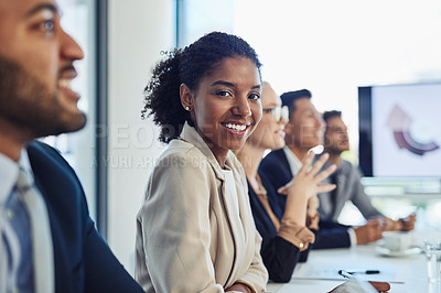 Buy stock photo Portrait of a confident young businesswoman having a meeting with colleagues in the boardroom of a modern office