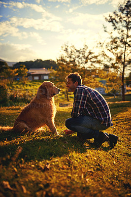 Buy stock photo Full length shot of a handsome young man and his dog spending a day in the park