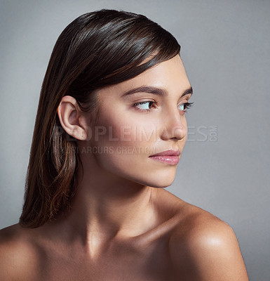 Buy stock photo Studio shot of a beautiful young woman posing against a gray background