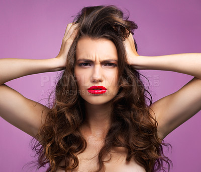 Buy stock photo Studio portrait of a beautiful young woman looking angry against a purple background