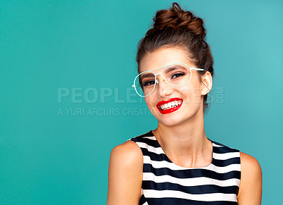 Buy stock photo Studio portrait of a beautiful young woman posing against a turquoise background