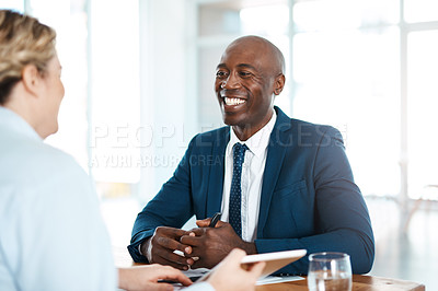 Buy stock photo Shot of a young businessman and businesswoman having a discussion in a modern office