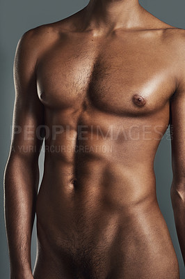 Buy stock photo Cropped studio shot of a muscular young man posing in the nude against a grey background