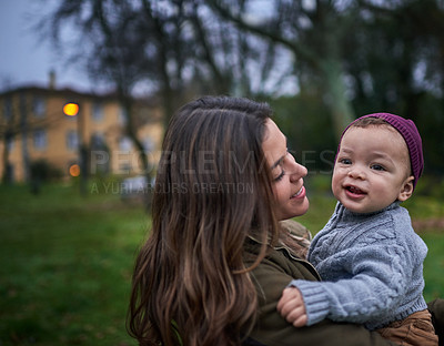 Buy stock photo Shot of a mother bonding with her little son outdoors