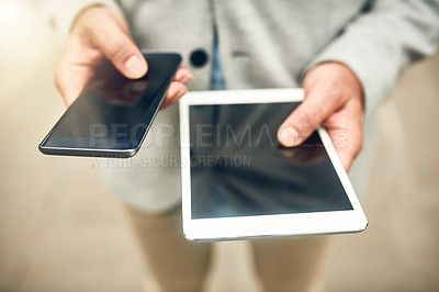 Buy stock photo Closeup shot of an unrecognizable businessman using a cellphone and digital tablet outdoors